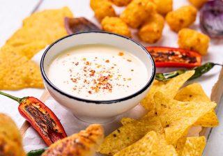Vegan cheese nachos with potato tots and paprika ciabatta sticksVegan cheese nachos with potato tots and paprika ciabatta sticks