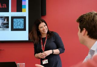 Kirsty from marketing giving a presentation