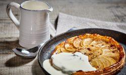 Macphie Plant-based Cream Alternative poured on tarte tatin