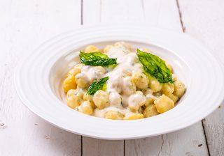 Potato gnocchi with basil cream sauce